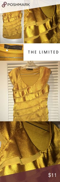 Sleeveless Ruffled front gold round neck Shirt Gold, front Ruffle, 100% Polyester sleeveless shirt. I wore it to work with a casual jacket or wore it with a ruffle bottom skirt. The Limited Tops Tunics