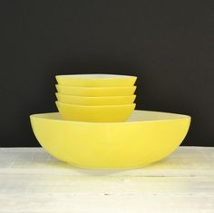 Vintage Pyrex - Yellow Hostess Set - Square Bowls - Yellow Salad Set. $54.00, via Etsy. Got two different sizes of the nappy bowls, just need one more little one.  Also have two yellow large bowls.