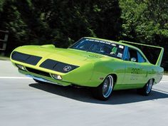1970 Plymouth Road Runner Superbird. A highly modified version of the Road Runner, it was designed specifically for NASCAR Featuring a protruding aerodynamic nosecone, high-mounted rear wing, and a horn which mimicked the Road Runner cartoon character. It came with a 426 Hemi V8 up to a Super Commando 6bbl V8 engine.