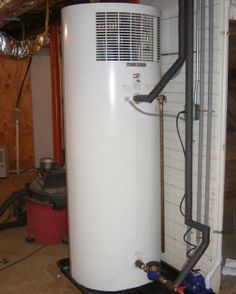 A Stiebel Eltron Heat Pump Water Heater placed in a basement. One of the best in the industry, Stiebel Eltron has been making the most reliable electric water heaters for nearly a century. Note how tall the unit is!