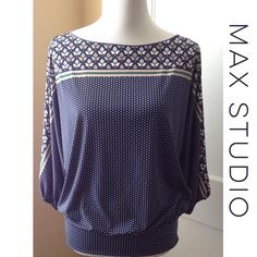 MAX STUDIO Pretty Dolman Sleeve Top This lovely printed dolman sleeve top by MAX STUDIO will make a perfect addition to your wardrobe! Floral motif across top with polka dot print below. Navy blue, white, green and gray. 95% polyester, 5% spandex. Gently preloved and in excellent condition. Max Studio Tops Tees - Long Sleeve