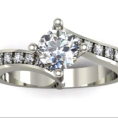 Ring of the week sku: DESIGNER020. Round cut centre diamond and diamond set swooping sides @ www.diamondsandrings.co.uk