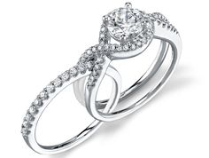 i love the idea of the wedding band and engagement ring fitting together or intertwining!