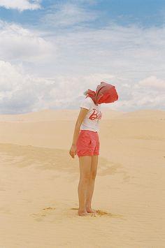 photograph, desert, pink shorts, sand, head scarf,