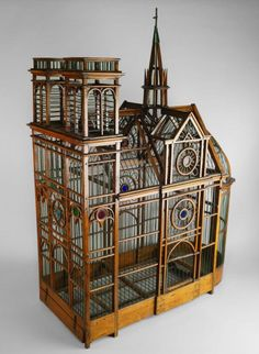 A large wooden bird cage, late 19th/early 20th century, in the form of a cathedral, 95cm high - Price Estimate: £1000 - £1500