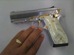 Taurus pt945 stainless gold w/ pearl grips. Save those thumbs & bucks w/ free shipping on this magloader I purchased mine http://www.amazon.com/shops/raeind  No more leaving the last round out because it is too hard to get in. And you will load them faster and easier, to maximize your shooting enjoyment.