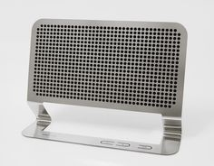 'thin boom-box', a small speaker which incorporates future technology  focused on flat electrical components. by using 0.5mm thin stainless steel, its volume and material are highly reduced