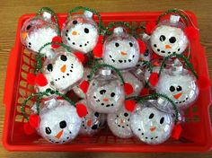 snowman ornament, cute.  clear ornament, snow poured inside, draw on face, pom pom glued to side for ear muffs, and pipe cleaner
