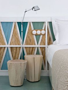 wall decoration with painted bamboo in a beach house with a cool toned colour palette
