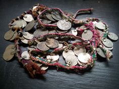 Old coins on vintage textile strips salvaged from Afghan clothing and textiles. Great for use in tribal belly dance costuming. Silk Road Tribal.