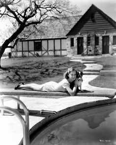 Barbara Stanwyck with her dog on the diving board at Marwyck 1937.