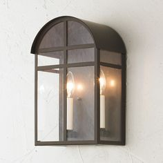 Arched Craftsman Outdoor Light From Craftsman homes with eyebrow windows to modern California cliff houses, this arched roof outdoor light becomes one with the style! Bronze powdercoat finish with clear glass.