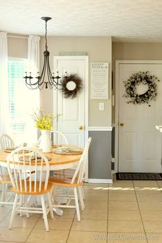 Freshen up your kitchen or dining room with some new paint!  My breakfast area in the kitchen got a lighter/brighter makeover with some @behrpaint.  Behr Wheat Bread on top and Behr Creek Bend on the bottom.