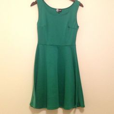 Emerald green dress Flattering seams around the bust and waist. Material allows for stretch so the fit is very comfortable! Dresses Midi