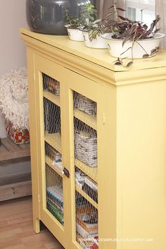 MS Magnolia Yellow painted pie safe with chicken wire doors.