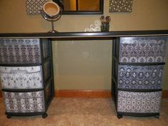 DIY vanity. Dressed up regular plastic rolling storage bins with scrapbook paper and mod podge.