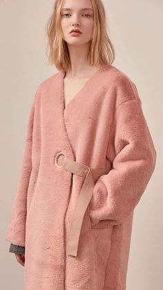 The Valenxina Shearling Coat in pink. Super soft, clean, collarless with V-neckline silhouette and outlined with brick suede. Dropped shoulder, wrap front with button closing. Fashion Mode, Fur Fashion, Fashion Week, Fashion Details, Winter Fashion, Fashion Outfits, Womens Fashion, Fashion Design, Fashion Trends