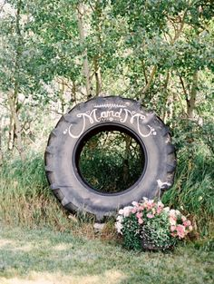 Personalized tractor wheel farm wedding decor: http://www.stylemepretty.com/canada-weddings/2015/06/23/7-farm-wedding-details-we-love/