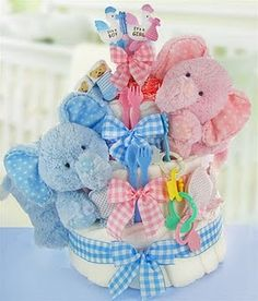 Twin baby shower diaper cake.. I think this is the one!!!     =)  Aundreana's having twins and what better one to make.