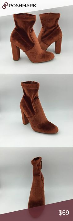 Steve Madden Edit Orange Rust Ankle Bootie Microsuede, velvet, or stretch PU upper Man-made lining Man-made sole 4 inch heel height 10 inch shaft circumference 5 inch shaft height Functional inside zipper Shaft stretches for wider fit Block heel Almond toe Color: Rust, Orange A8 A29 Steve Madden Shoes Ankle Boots & Booties