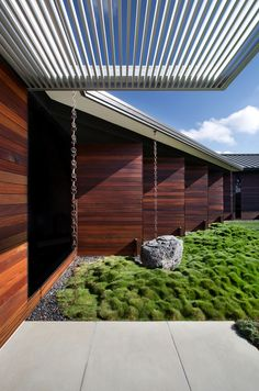 Hilltop Residence Rawin chain over rock and green moss is softened effect