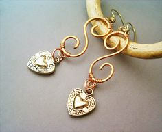 Hey, I found this really awesome Etsy listing at https://www.etsy.com/listing/168297362/steampunk-earrings-copper-and-hearts