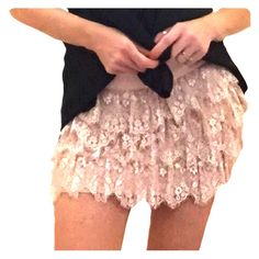 Pink lace mini skirt This is lined...(100%polyester) tag says medium but these fit more like a small. The measurements lying flat are.... Waist 14 1/2 inches.   Hip is 16 1/2 inches length from waist is 13 1/2 inches Skirts Mini