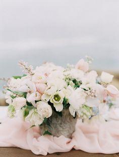 Delicate Blush Pink Centerpiece on a Silk Runner | Carmen Santorelli Photography | http://heyweddinglady.com/delicate-cherry-blossom-wedding-ideas-rose-quartz