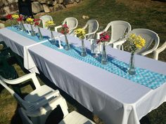 Rehearsal dinner: Our table set up #backyard #rehearsaldinner #chevron table runner #ikea vases filled with fresh yellow pink and red flowers