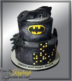 "Two tier Batman cake with hand crafted Batmobile cake topper. Check out some of my other creations at (and dont forget to ""like it"" while you are there) https://www.facebook.com/cakesbykayleighboesiger"