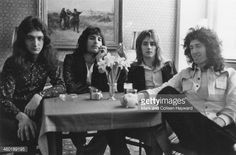 English rock group Queen posed in a cafe in the Netherlands on 22nd November 1974 Left to right John Deacon Freddie Mercury Roger Taylor and Brian May Photo by Mark and Colleen Hayward
