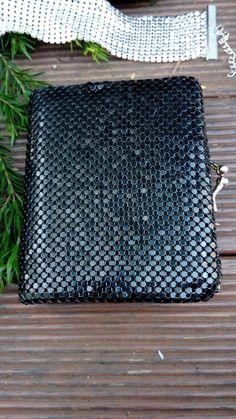 Modern mesh op shop find - an unbranded (tags have been cut off) black metal mesh clutch wallet.