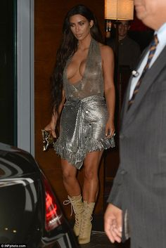 Flawless: Kourtney's younger sister Kim looked equally lovely in a silver chain-inspired dress that revealed her ample cleavage