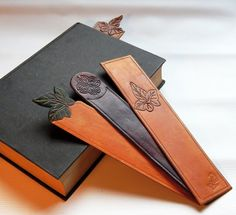 Leather bookmarks for all bibliophiles because books are never out of vogue and reading is cool again. This is what you need. Slim enough bookmark that will not strain the spine but remain tactile and attractive. These stylish bookmarks are individually crafted from vegetable tanned leather, embossed with a leaf or Celtic knot (and my logo), decoratively edged, lightly stained to give an aged appearance and finally treated with an acid free finish. Can be personalised - details on separate…