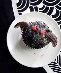 Bat cupcakes with Peppermint Patty wings and red Jujube eyes.