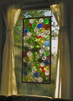 A stained glass window using cut wine bottle bottoms.  I wish I could do this.