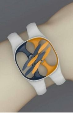 """Nixie Wrist Wearable Flying Drone - As if the world needed more items to put on our wrists, a startup company called Nixie (yes, another Nixie) is developing a wearable flying drone. This is all part of Intel's """"Make It Wearable"""" challenge, where the chip producer has challenged teams to produce a new wave of wearable technology. Nixie's idea is to produce a small drone that can be wrapped on your wrist and taken with you. The company is developing a few prototypes, and it is unclear what…"""
