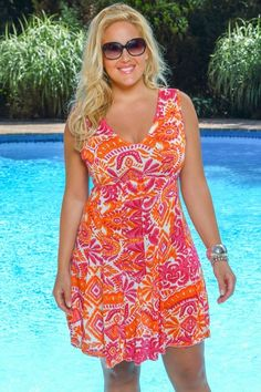 Grab your umbrella drink and set your eyes on the horizon - relax and enjoy in this beautiful tropical print plus size sun dress from the Always For Me cover collection. Available in pink/orange womens sizes 1x-3x