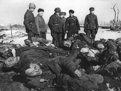 """""""Soviet soldiers come across a pile of Russian POWs tortured and murdered by the Germans, winter 1941-42. These atrocities were routine given the German orders to eliminate Russian POWs whenever possible."""""""
