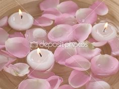 Spa Floating Candles And Rose Petals In Water | Стоковая фотография © Subbotina #10677130