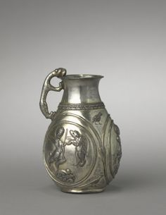 6-7th c. silver Zorastrian-Sasanian Hunt Pitcher (5 1/4 x 3 1/2 in.) - Cleveland Museum of Art 1961.200