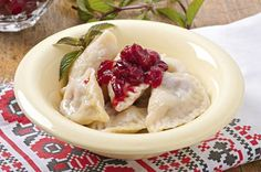 UKRAINE:  Varenyky - Dumplings stuffed with mashed potatoes, ground meat, cabbage or fish.  They may also have sweet fillings like cottage cheese, cherries and berries.