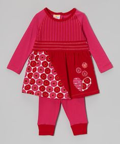 The essence of cheerful! This matched set brightens the little girl's day with a precious design and vibrant color. The stretchy cotton dress has a generous neck for easy changing, while the leggings bring a kick of warm whimsy to the ensemble.