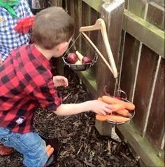 My little boy and my mindees loved weighing out all the fruit and veg from our farm shop on these homemade scales. Outdoor Maths Ideas - Twinkl Blog