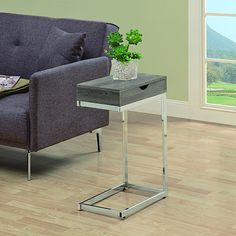 "What a convenient way to eat or drink on your couch! This beautiful dark taupe reclaimed wood-look, hollow-core accent table offers sufficient space for you to place your snacks, drinks and even meals. A large drawer provides hidden storage for magazines, mobile devices and remote controls. Its chromed metal base provides sturdy support along with a fashionable flair that will suit any décor. Materials: Hollow Board, MetalColor/Finish: Taupe, ChromeDimensions: 16""L x ..."