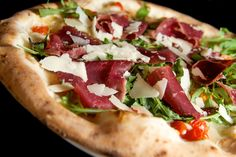 Primavera AED59 A delicious treat with a combination of mozzarella, slices of bresaola, parmesan shavings, fresh cherry tomatoes, rocket and basil.