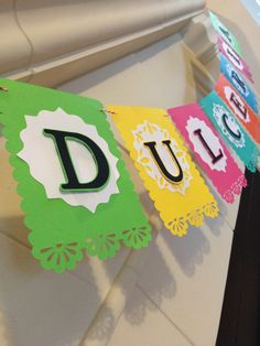 We could make a bunch of bright bunting banners like this (feliz cumpleaños, taco 'bout a party, fiesta like there's no mañana)