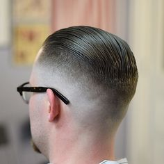 High fade with slicked back top