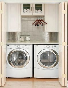 Small Laundry Room Ideas | In a small room, stacking the washer on top of the dryer provides you ...