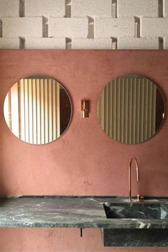 pink bathroom ideas pink bathroom with two circular mirrors